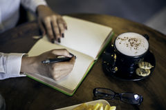 Woman writing her notebook Royalty Free Stock Photography