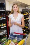 Woman writing in her notepad in aisle Stock Images