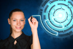 Woman writing on holographic screen Royalty Free Stock Image