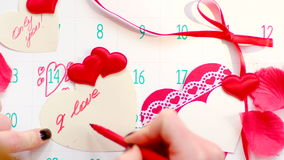 Woman writing I LOVE YOU on valentine stock footage