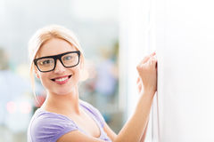 Woman writing ideas on adhesive notes Royalty Free Stock Image