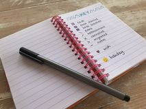 Bullet journal with a pen on a wooden desk stock photos