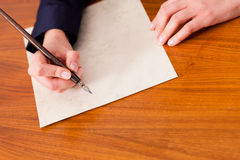 Woman writing a letter with pen and ink Stock Images
