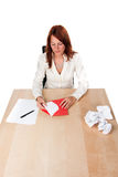 Woman writing love letter - high. High angle shot of a woman that finishes her love letter with rejected versions on the right. On white background stock photo
