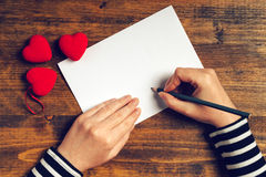 Woman writing love letter for Valentines day Royalty Free Stock Photo