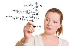 Woman writing mathematical formula Royalty Free Stock Photos