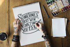 A woman is writing a motivation quote Stock Images