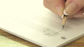 Woman writing music notes stock video