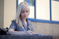 Woman writing a note Stock Photography