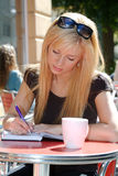 Woman writing in a notebook Royalty Free Stock Image