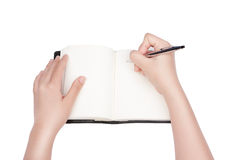 Woman writing in notebook. Woman hand writing in notebook Stock Photo