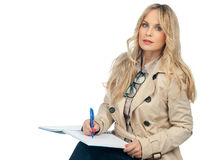 Woman writing in the notebook royalty free stock photography