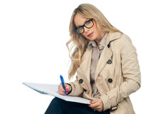 Woman writing in the notebook royalty free stock photo