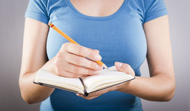 Woman Writing In Notebook Royalty Free Stock Photo