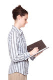 Woman writing in notebook - side view Royalty Free Stock Image