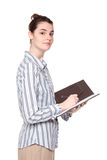 Woman writing in notebook - side view Royalty Free Stock Photos
