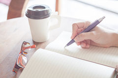 Woman writing on notebook Royalty Free Stock Photography