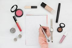 Woman writing on a notepad in a beauty concept royalty free stock photography