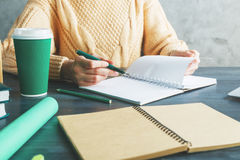 Woman writing in notepad Stock Photos
