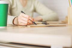 Woman writing in notepad Royalty Free Stock Photos