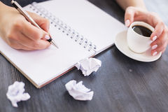 Woman writing in notepad Royalty Free Stock Photo