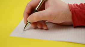 Woman writing notes in notebook, close up steady footage with selective focus on hand stock footage