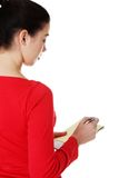 Woman writing notes and planning her schedule Royalty Free Stock Images