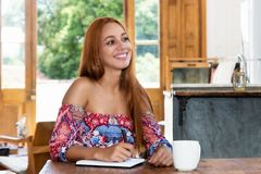 Woman writing notes and planning her schedule stock photography