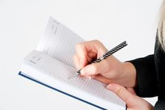 Woman writing in organizer Stock Images