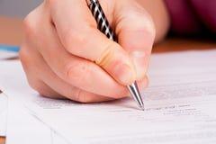 Woman writing in organizer Stock Image