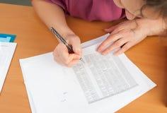 Woman writing in organizer Royalty Free Stock Photo