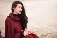 Woman writing outdoors Royalty Free Stock Photography