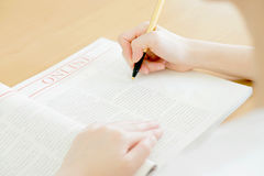 Woman writing on paper Stock Image