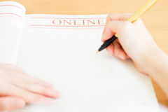 Woman writing on paper Royalty Free Stock Photo