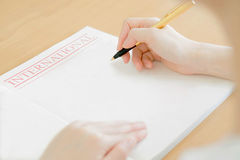 Woman writing on paper Stock Photos