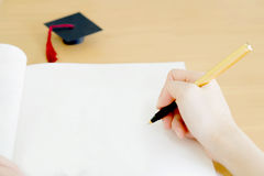 Woman writing on paper Stock Photography