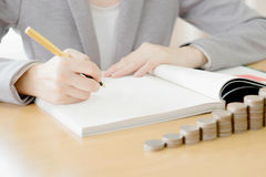 Woman writing on paper Royalty Free Stock Photos