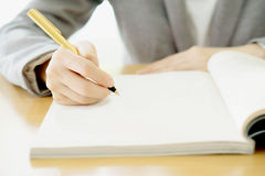 Woman writing on paper Royalty Free Stock Image
