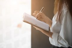 Woman writing paper with vintage tone. Stock Photos