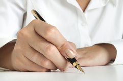 Woman Writing with pen Stock Image