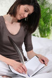 Woman writing with pen Stock Images