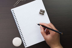 Woman writing with pencil Royalty Free Stock Photos