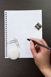 Woman writing with pencil on notebook Stock Images