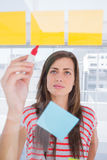 Woman writing on the planning Stock Image