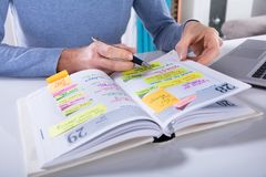 Free Woman Writing Schedule In Calendar Diary On White Desk Royalty Free Stock Image - 126291986