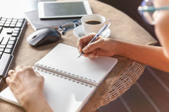 Woman writing shot memories note on white paper with relaxing ti. Me and emotion stock photos