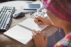 Woman writing shot memories note on white paper with relaxing ti Stock Photography