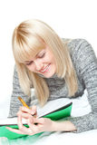 Woman writing and smiling Stock Photos