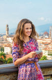 Woman writing sms in florence, italy Stock Photography