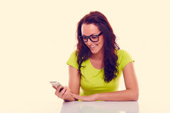 Woman writing sms. Toned Royalty Free Stock Photo